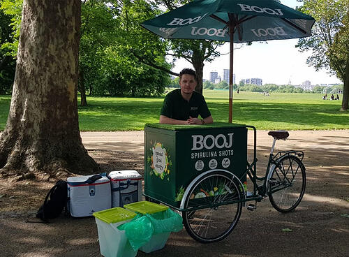 Booj promotional bike set up in a city park - an ideal product sampling location