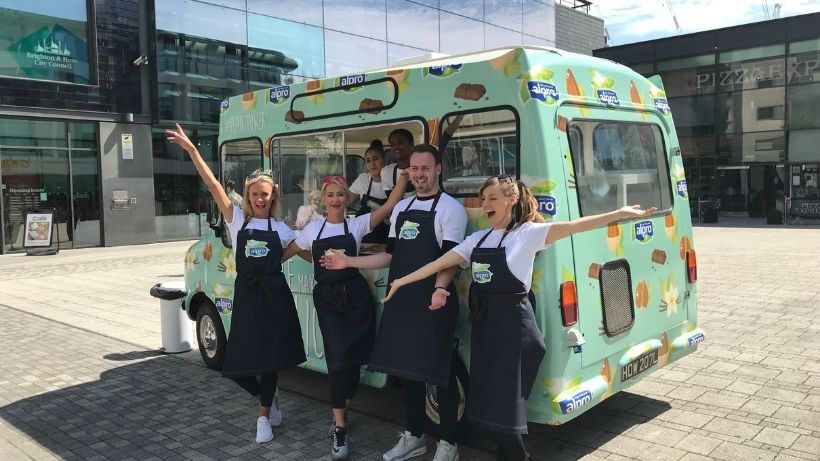 Promotional team standing in front of Alpro ice cream van