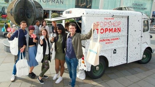 Promo support services - Topman branded vehicle with group posing outside with freebies