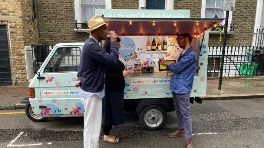 Doorstep promotional campaign - Couple sampling wine from Piaggio Ape wine bar